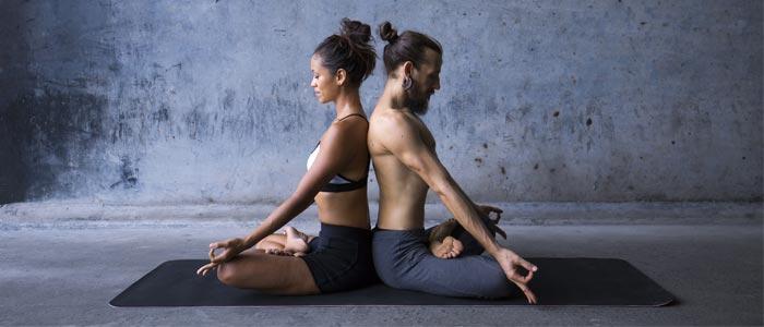 Couple practising yoga