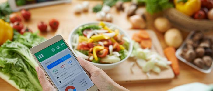 Woman counting calories on an app