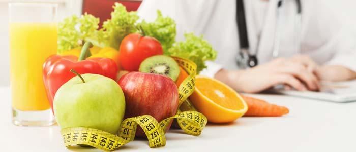 Doctor sat in front of healthy foods