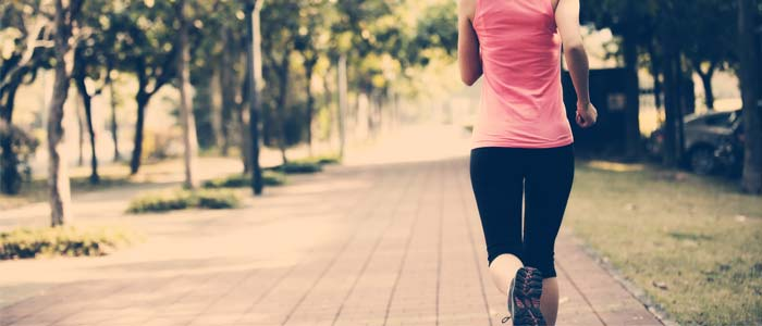 Rear shot of woman running