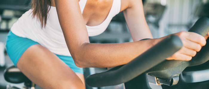 Close up shot of an exercise bike being used