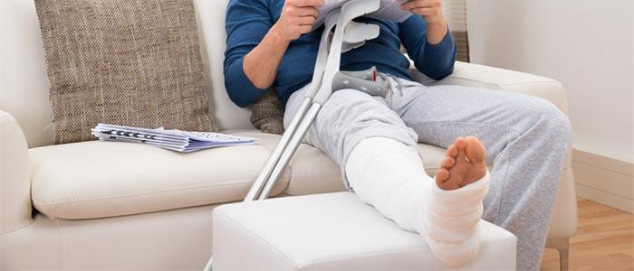Man resting with a broken leg