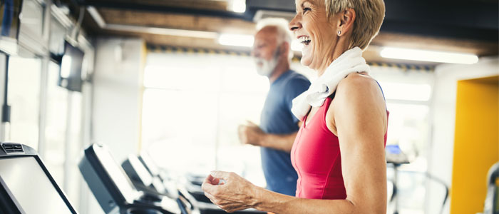 couple running on a treadmill