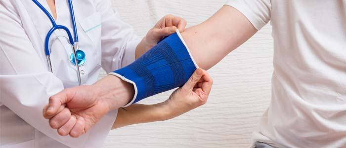 Nurse applying a compression bandage to a patient