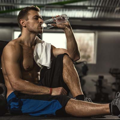 Man taking a rest in the gym between sets