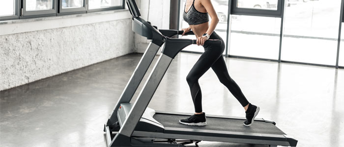 Woman walking on an incline treadmill