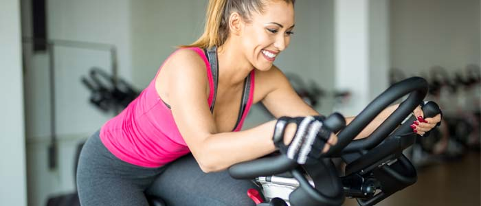 Woman smiling on an exercise bike