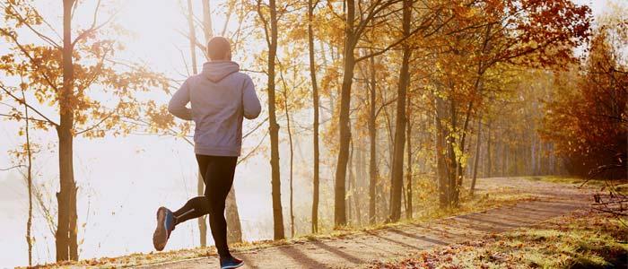 Man jogging through a park