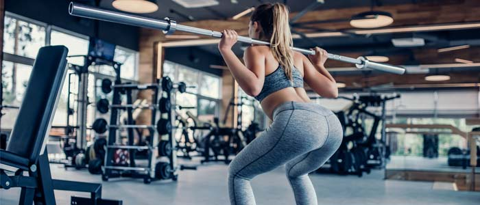 Woman squatting with a barbell