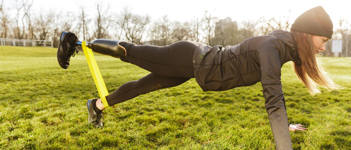 woman performing a plank with a resistance band