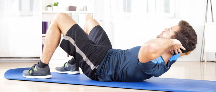 man doing push-ups on a mat