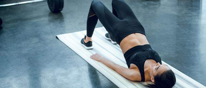 woman performing a bridge exercise