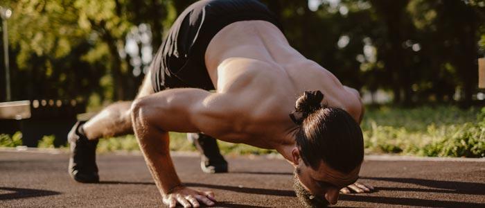 Man performing shoulder push ups