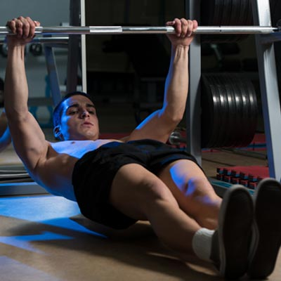 Man performing inverted rows