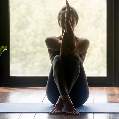 Woman performing a relaxing yoga pose