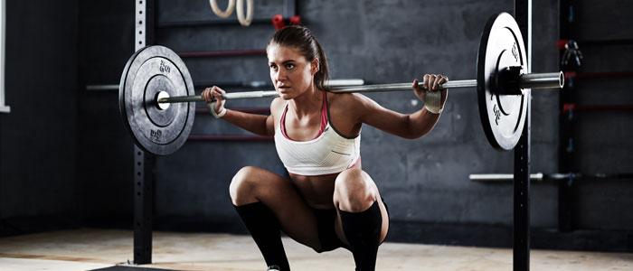 woman performing a barbell squat