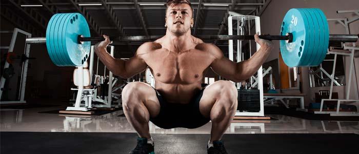 Man squatting huge weight