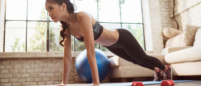 Woman trying to build muscle at home