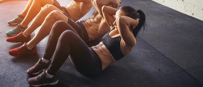 group of people doing ab crunches
