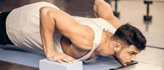 Man using yoga blocks