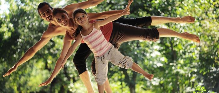 weight genetics fit family practising yoga