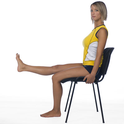 Woman exercising on a chair