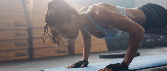 woman doing body weight exercise