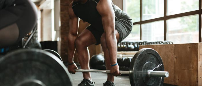 Man lifting heavy weights to build muscle
