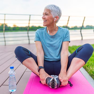 Woman doing exercise outdoors