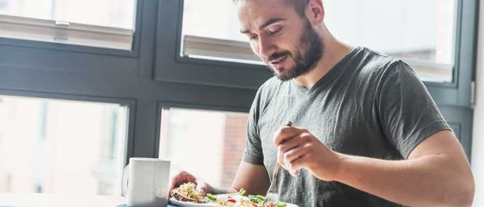 Man eating with intermittent fasting in place
