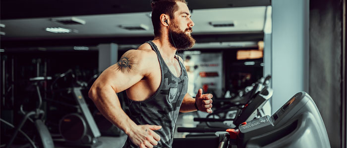 Man doing a treadmill HIIT workout