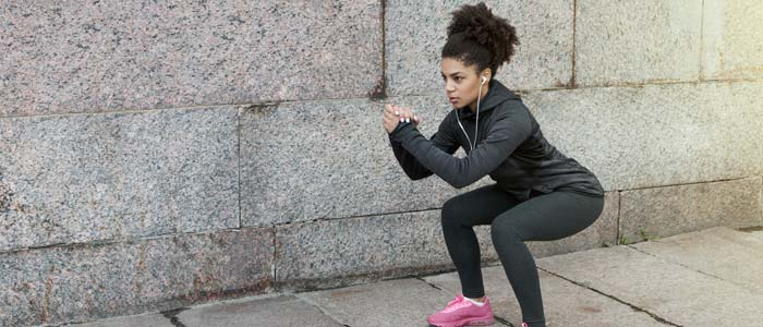 Woman doing body weight squat variation