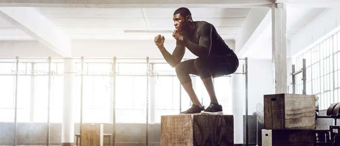 Man doing squat jumps