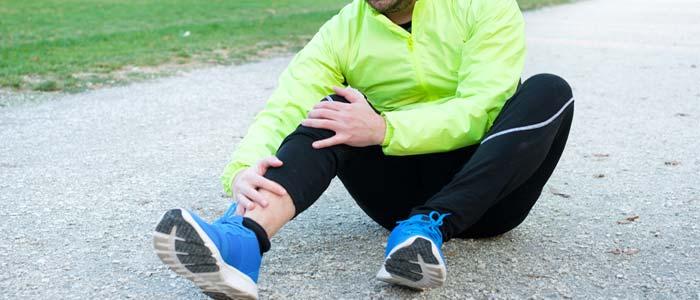 Man dealing with over training injury symptom