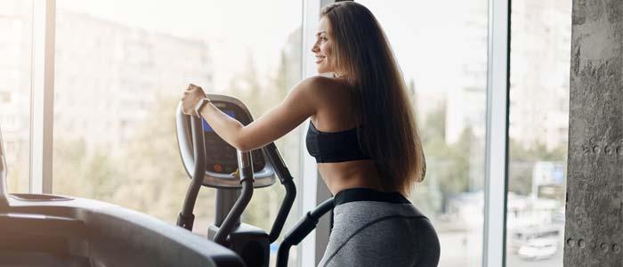 Woman doing a cross trainer workout plan