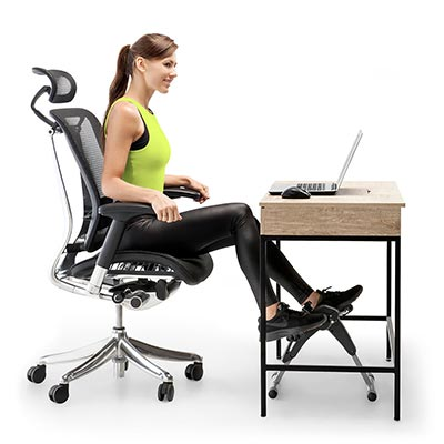 Woman using a desk bike to exercise at her job