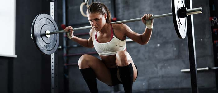Woman squatting a barbell