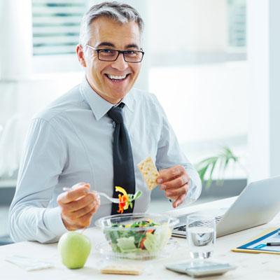 Man eating healthily at work