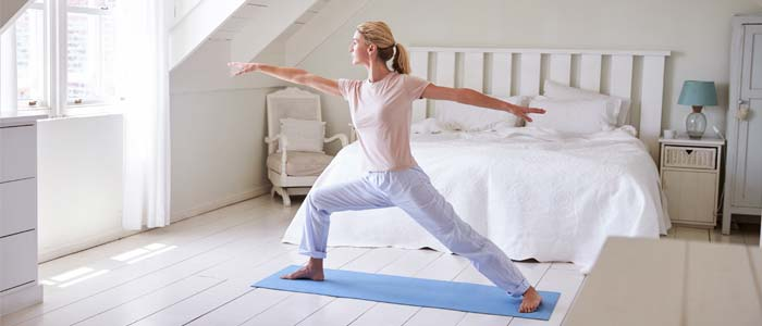 Woman keeping fit with morning exercise