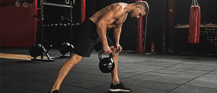Man doing kettlebell row