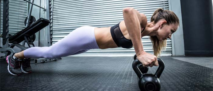 Woman doing kettlebell push up