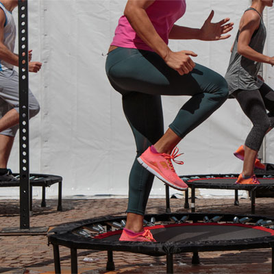 Group on people on fitness trampolines