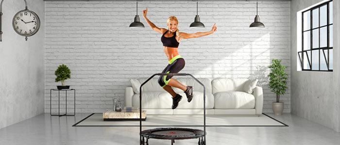 Woman using a Marcy fitness trampoline in her living room