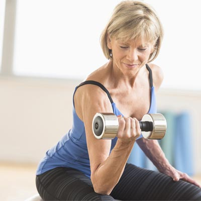 Woman bicep curling a dumbbell