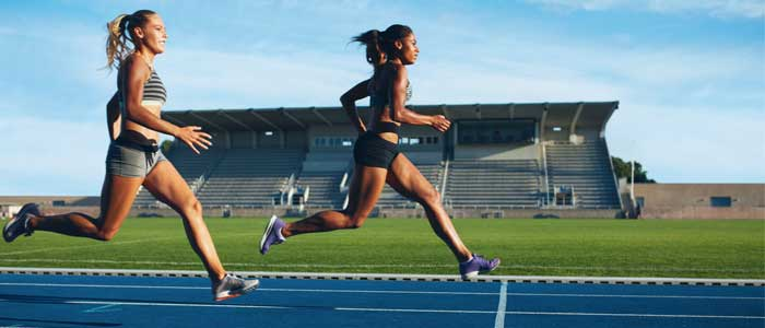 Women running on a track