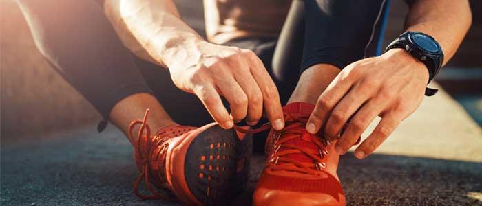 Runner adjusting their running shoes