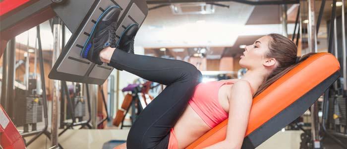 Woman using a leg press machine