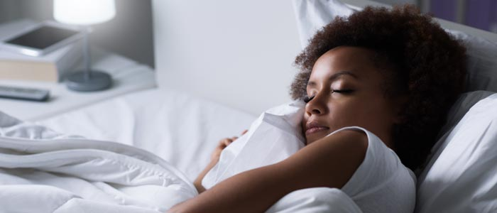 Woman sleeping in her bed