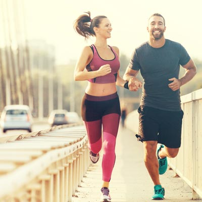 Motivated couple running together