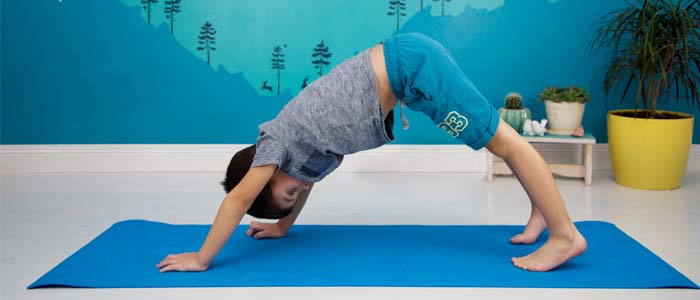 Child doing downward dog yoga pose